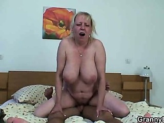 Huge titted oldie is picked up from the street and fucked